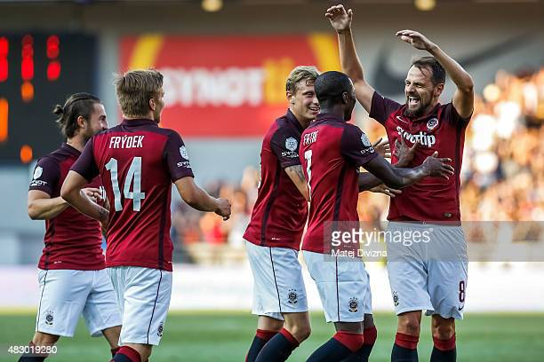 Kehinde Fatai and Ladislav Krejci of Sparta Prague celebrate their second goal with their teammates during the UEFA Champions League Third Qualifying...