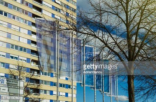 Kehl city welcom flags agains blue sky : Foto stock