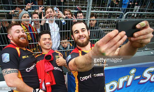 Kehoma Brenner Jeremy Te Huya and Sean Armstrong of Germany take a selfie with the fans after the European Nations Cup match between Germany and...