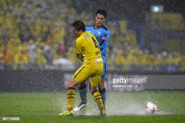 Kei Chinen of Kawasaki Frontale and Shinnosuke Nakatani of Kashiwa Reysol compete for the ball during the JLeague J1 match between Kashiwa Reysol and...