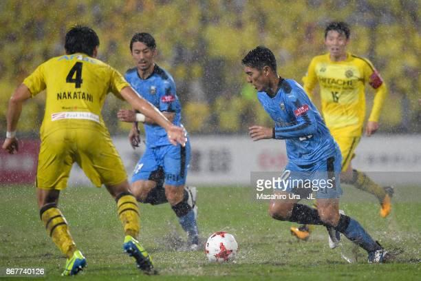 Kei Chinen of Kawasaki Frontale takes on Shinnosuke Nakatani of Kashiwa Reysol during the JLeague J1 match between Kashiwa Reysol and Kawasaki...