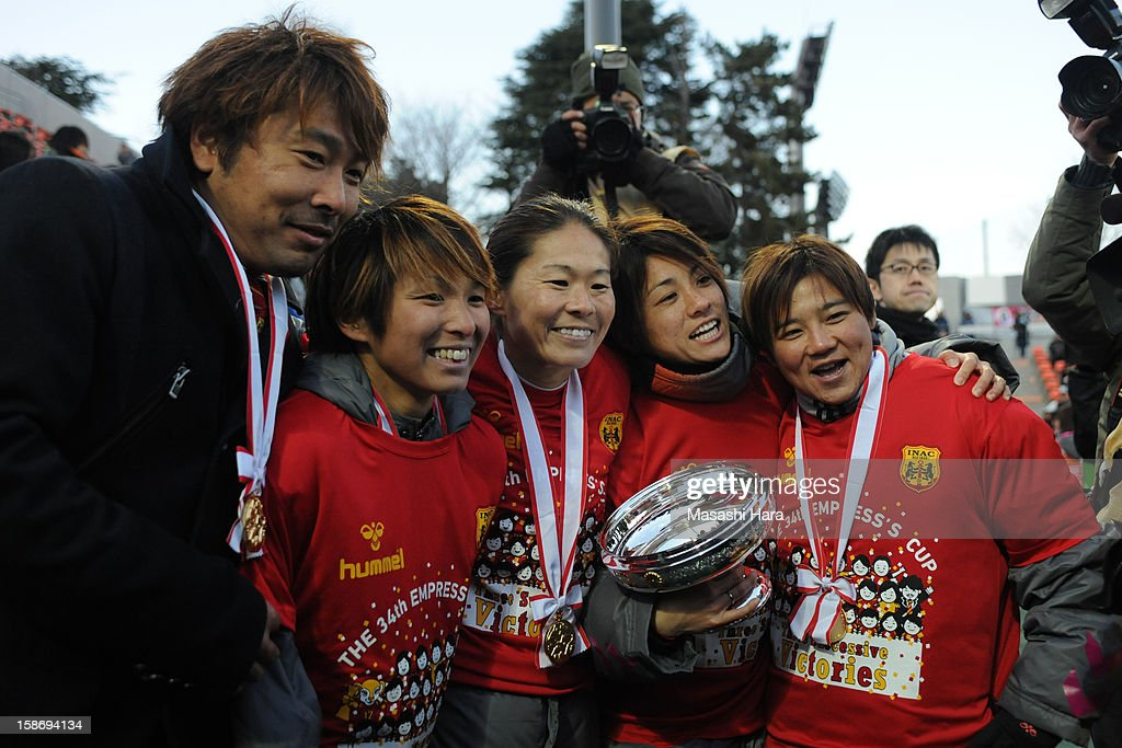 Kei Hoshikawa,coach of INAC Kobe Leonessa and players look on after the 34th Empress's Cup All Japan Women's Football Tournament final match between INAC Kobe Leonessa and JEF United Chiba Ladies at Nack 5 Stadium Omiya on December 24, 2012 in Saitama, Japan.