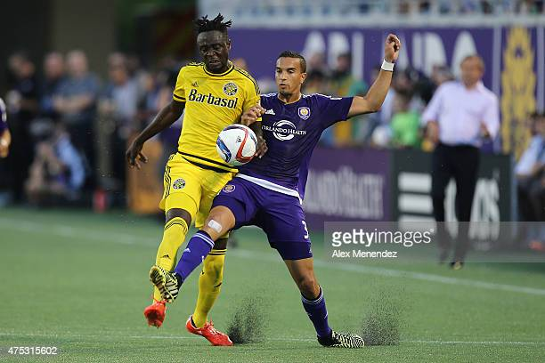 Kei Kamara of Columbus Crew and Seb Hines of Orlando City SC fight for the ball during a MLS soccer match between the Columbus Crew and the Orlando...