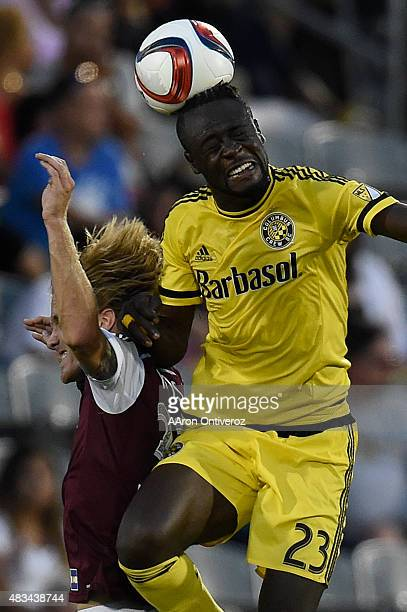 Kei Kamara of Columbus Crew heads the ball over Jared Watts of Colorado Rapids during the first half of action The Colorado Rapids hosted the...