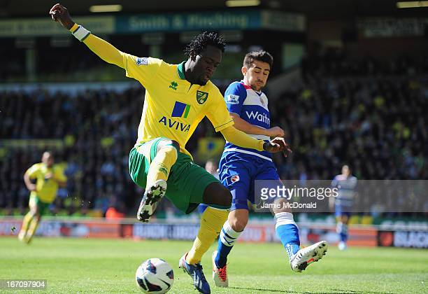 Kei Kamara of Norwich City battles with Jem Karacan of Reading during the Barclays Premier League match between Norwich City and Reading at Carrow...