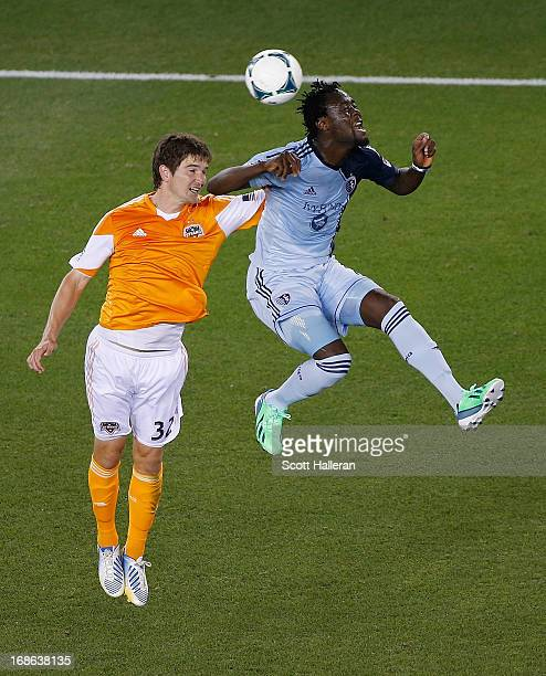 Kei Kamara of Sporting Kansas City fights for the ball against Bobby Boswell of the Houston Dynamo in the second half at BBVA Compass Stadium on May...