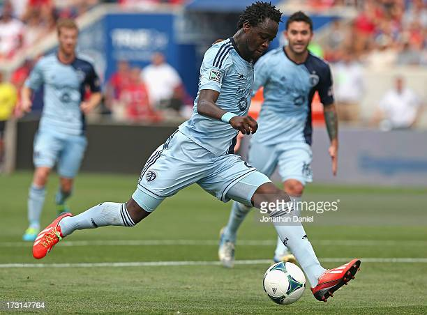 Kei Kamara of Sporting Kansas City moves up the field against the Chicago Fire during an MLS match at Toyota Park on July 7 2013 in Bridgeview...