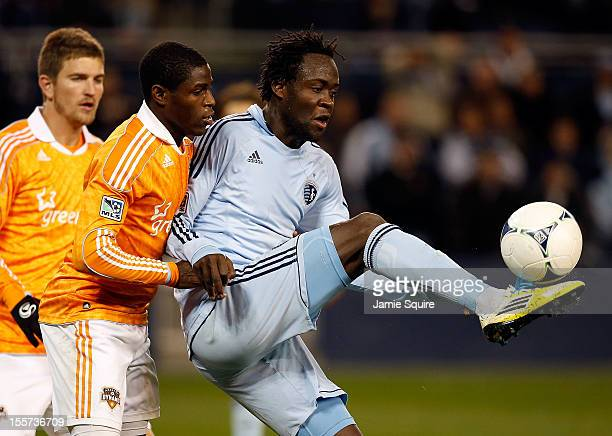 Kei Kamara of Sporting KC controls the ball as Kofi Sarkodie of Houston Dynamo defends during the Eastern Conference Semifinal game at LiveStrong...