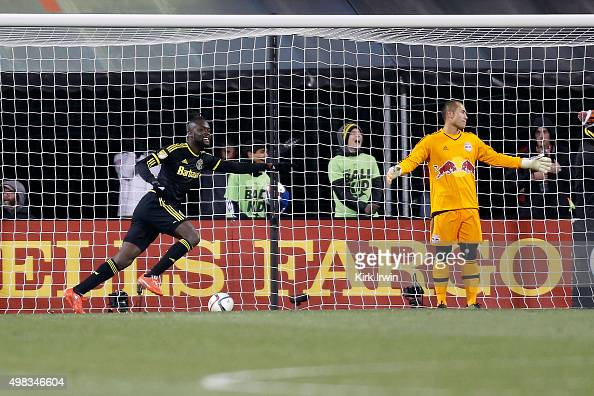 Kei Kamara of the Columbus Crew SC celebrates as Luis Robles of the New York Red Bulls reacts to giving up a goal during the second half on November...