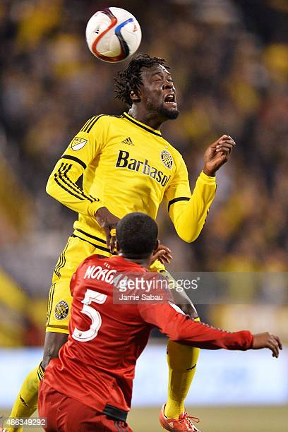 Kei Kamara of the Columbus Crew SC gains control of the ball as Ashtone Morgan of Toronto FC defends in the second half on March 14 2015 at MAPFRE...