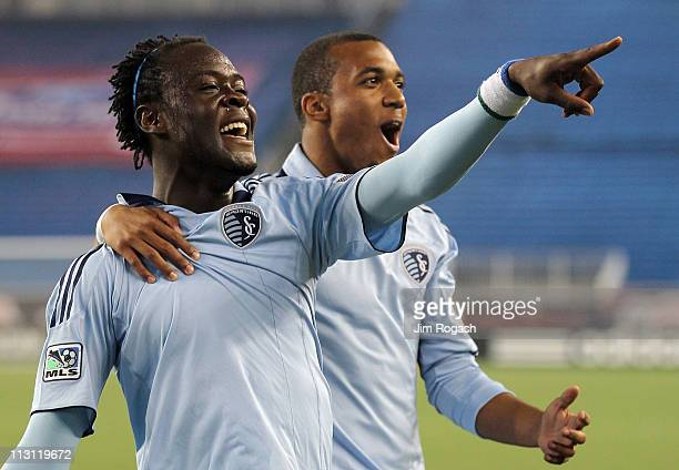 Kei Kamara of the Sporting Kansas City reacts with teammate Teal Bunbury after scoring a tying goal against the New England Revolution at Gillette...