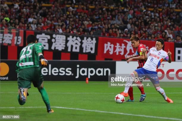 Kei Koizumi of Albirex Niigata and Hiroki Miyazawa of Consadole Sapporo compete for the ball during the JLeague J1 match between Consadole Sapporo...