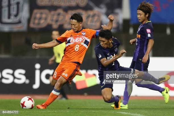 Kei Koizumi of Albirex Niigata and Hiroki Mizumoto of Sanfrecce Hiroshima compete for the ball during the JLeague J1 match between Albirex Niigata...