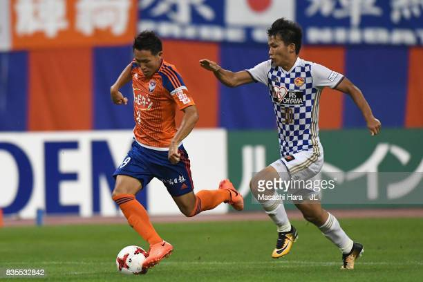 Kei Koizumi of Albirex Niigata and Takuma Nishimura of Vegalta Sendai compete for the ball during the JLeague J1 match between Albirex Niigata and...