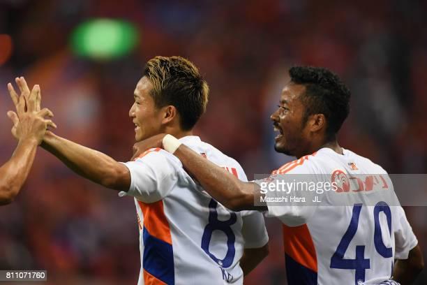 Kei Koizumi of Albirex Niigata celebrates scoring the opening goal with his team mate Musashi Suzuki during the JLeague J1 match between Urawa Red...