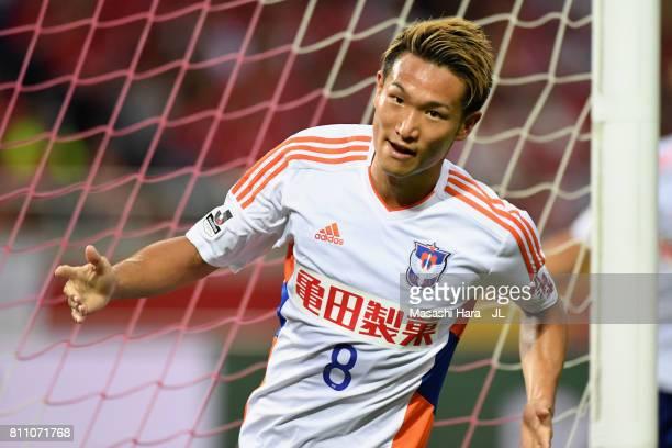 Kei Koizumi of Albirex Niigata celebrates scoring the opening goal during the JLeague J1 match between Urawa Red Diamonds and Albirex Niigata at...