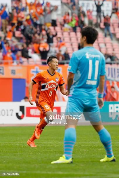 Kei Koizumi of Albirex Niigata celebrates scoring the opening goal with Rony of Albirex Niigata during the JLeague J1 match between Albirex Niigata...