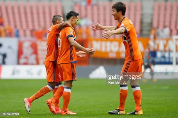 Kei Koizumi of Albirex Niigata celebrates scoring the opening goal with his team mates during the JLeague J1 match between Albirex Niigata and Sagan...