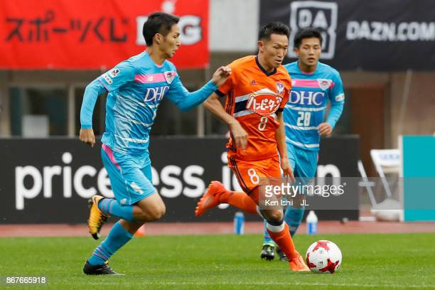 Kei Koizumi of Albirex Niigata controls the ball under pressure Riki Harakawa of Sagan Tosu during the JLeague J1 match between Albirex Niigata and...