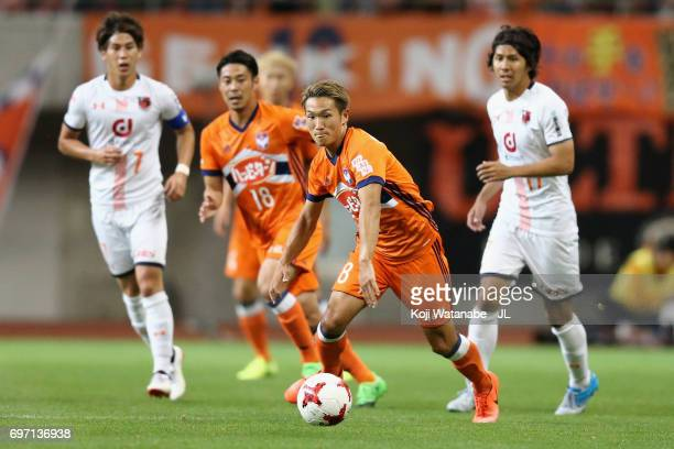 Kei Koizumi of Albirex Niigata in action during the JLeague J1 match between Albirex Niigata and Omiya Ardija at Denka Big Swan Stadium on June 17...