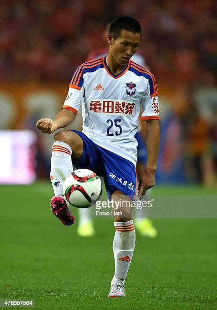 Kei Koizumi of Albirex Niigata in action during the JLeague match between Urawa Red Diamonds and Albirex Niigata at Saitama Stadium on June 27 2015...