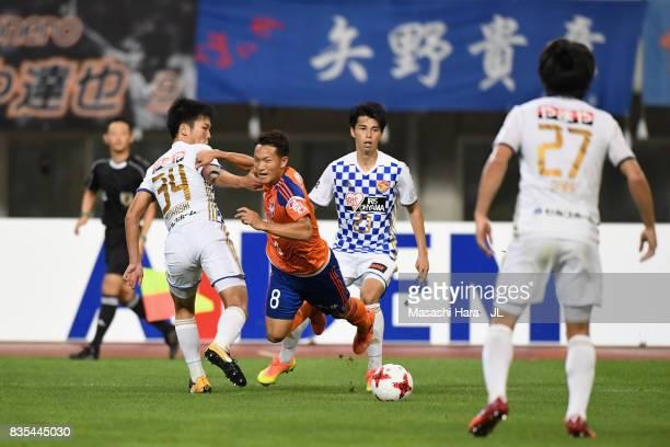 Kei Koizumi of Albirex Niigata is tackled by Keiya Shiihashi of Vegalta Sendai during the JLeague J1 match between Albirex Niigata and Vegalta Sendai...