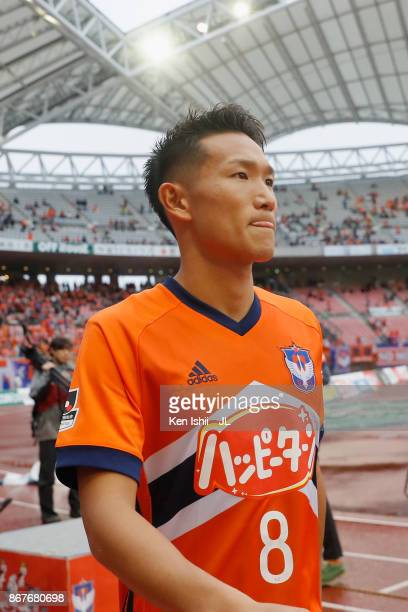 Kei Koizumi of Albirex Niigata leaves the pitch after his side's 10 victory in the JLeague J1 match between Albirex Niigata and Sagan Tosu at Denka...