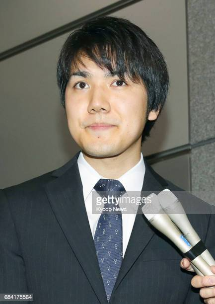 Kei Komuro who will soon become engaged to Princess Mako a granddaughter of Emperor Akihito meets the press near the office of a Tokyo law firm where...