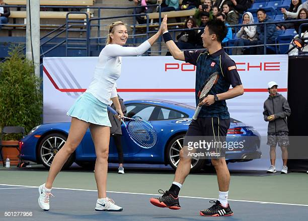 Kei Nishikori and Maria Sharapova at the Maria Sharapova and Friends tennis event presented by Porsche on December 13 2015 in Los Angeles California