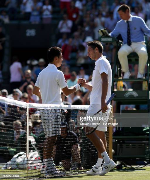 Kei Nishikori and Sergiy Stakhovsky shake hands after their match on day three of the Wimbledon Championships at The All England Lawn Tennis and...