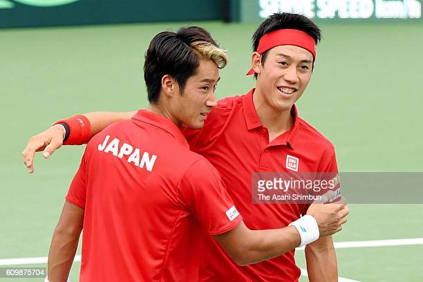 Kei Nishikori and Yuichi Sugita of Japan celebrates their win in the doubles game against Sergiy Stakhovsky and Artem Smirnov of Ukraine during day...