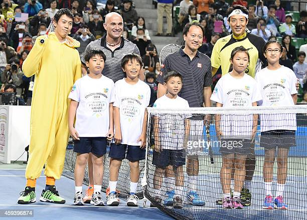 Kei Nishikori Andre Agassi Michael Chang and Shuzo Matsuoka attend the Dream Tennis exhibition match at Ariake Colosseum on November 22 2014 in Tokyo...