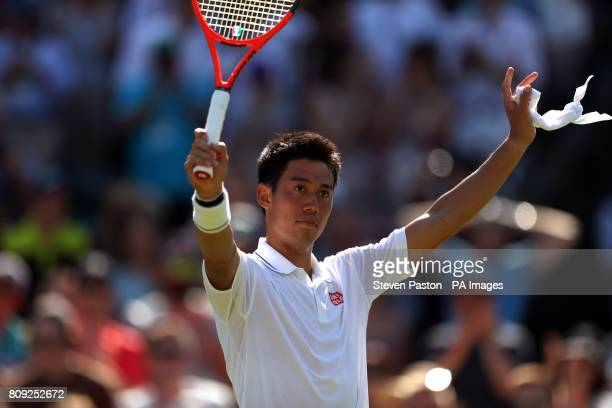 Kei Nishikori celebrates victory over Sergiy Stakhovsky on day three of the Wimbledon Championships at The All England Lawn Tennis and Croquet Club...