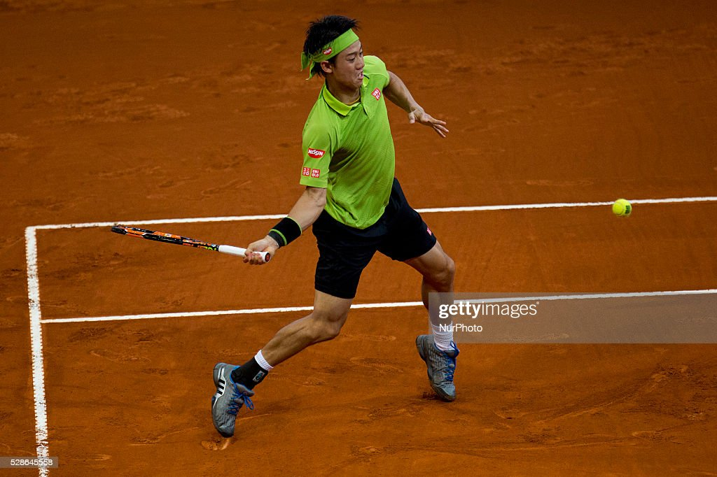 Kei Nishikori from japan returns a ball while playing against Nick Kyrgios from Australia, during a Madrid Open tennis tournament match in Madrid, Spain, Friday, May 6, 2016. Nishikori won 7-6, 6-7 and 3-6