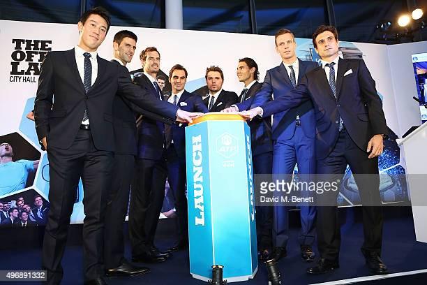 Kei Nishikori Novak Djokovic Andy Murray Roger Federer Stan Wawrinka Rafael Nadal Tomas Berdych and David Ferrer celebrate with Moet Chandon and...