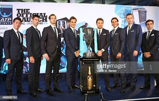 Kei Nishikori Novak Djokovic Andy Murray Roger Federer Stan Wawrinka Rafael Nadal Tomas Berdych and David Ferrer celebrate with Moet Chandon and...