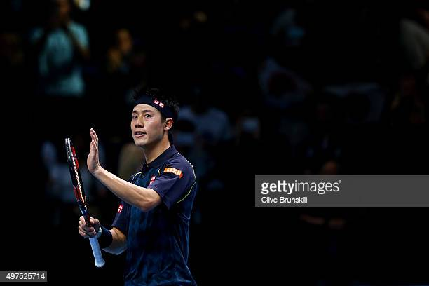 Kei Nishikori of Japan acknowledges the crowd after victory in his men's singles match against Tomas Berdych of Czech Republic during day three of...