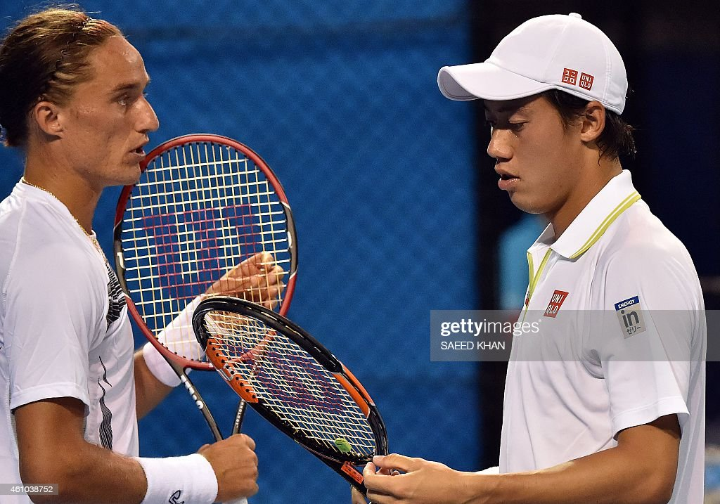 Kei Nishikori of Japan and Alexander Dolgopolov of Ukraine get ready to serve against Rohan Bopanna of India and Daniel Nestor of Canada during their...