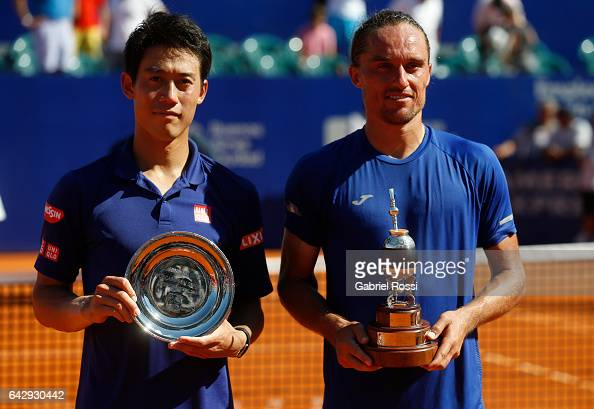 Kei Nishikori of Japan and Alexandr Dolgopolov of Ukraine pose with the trophy after finish the final match between Kei Nishikori of Japan and...