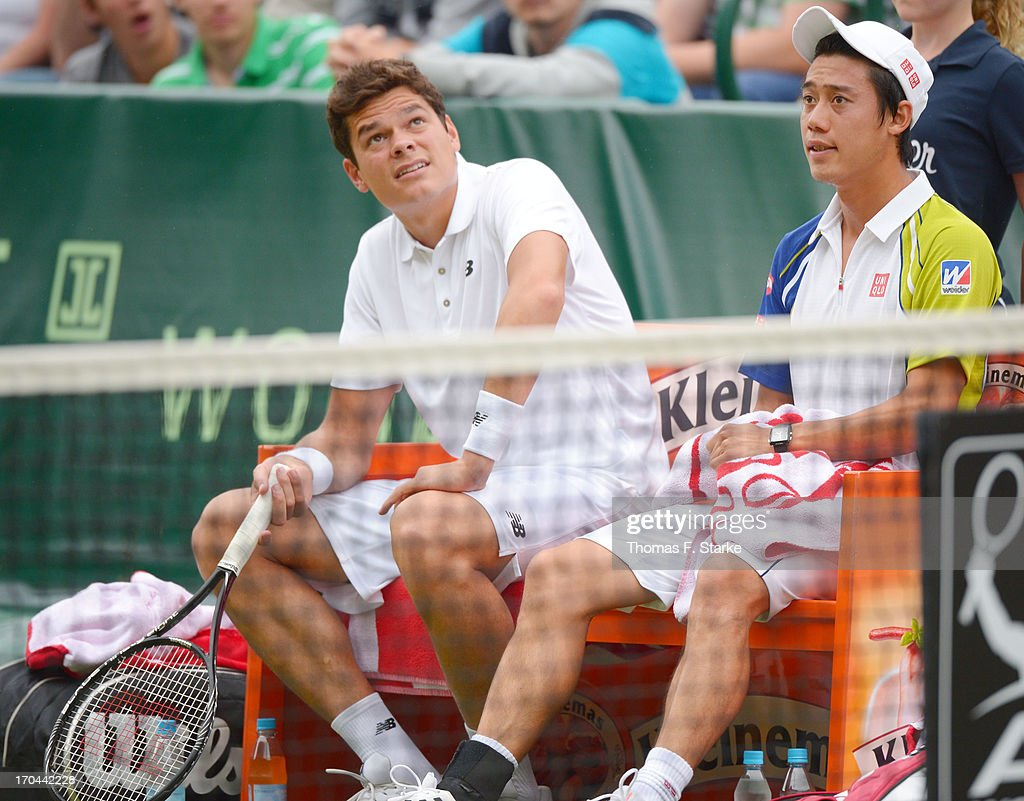 Kei Nishikori (R) of Japan and his doubles match partner Milos Raonic of Canada sit on the bench in their match against Philipp Kohlschreiber of Germany and Mikhail Youzhny of Russia during day four of the Gerry Weber Open at Gerry Weber Stadium on June 13, 2013 in Halle, Germany.