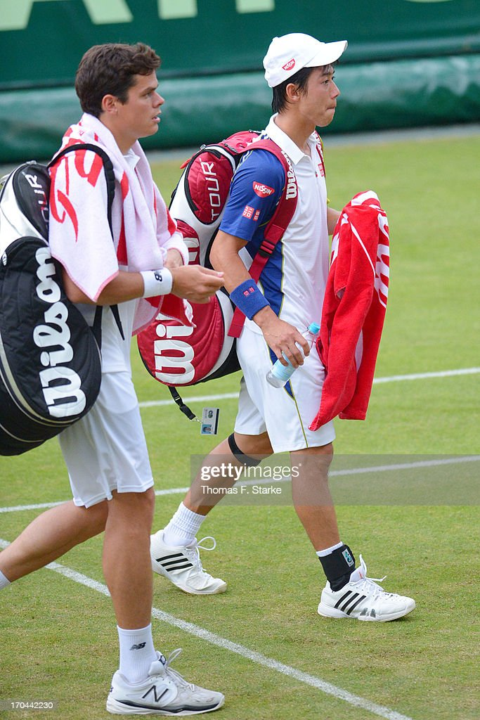 Kei Nishikori (R) of Japan and his doubles match partner Milos Raonic of Canada leave the court after loosing their match against Philipp Kohlschreiber of Germany and Mikhail Youzhny of Russia during day four of the Gerry Weber Open at Gerry Weber Stadium on June 13, 2013 in Halle, Germany.