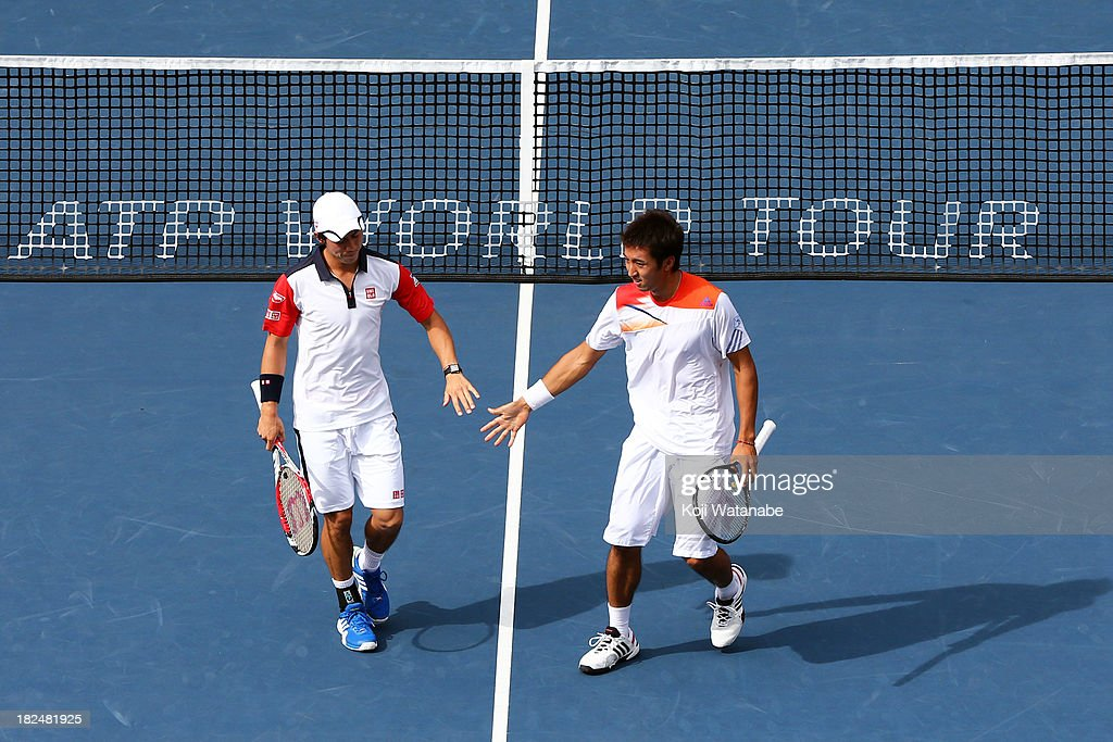 Kei Nishikori of Japan and Yasutaka Uchiyama of Japan during the men's first round doubles match against Ivan Dodig of Czech Republic and Marcelo Melo of Brazil during day one of the Rakuten Open at Ariake Colosseum on September 30, 2013 in Tokyo, Japan.