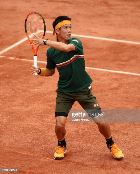 Kei Nishikori of Japan awaits to return the ball during the mens singles first round match against Thanasi Kokkinakis of Australia on day three of...