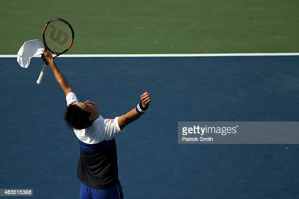 Kei Nishikori of Japan celebrates after defeating John Isner of the United States in the men's singles final during the Citi Open at Rock Creek Park...