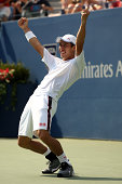 Kei Nishikori of Japan celebrates after defeating Novak Djokovic of Serbia in their men's singles semifinal match on Day Thirteen of the 2014 US Open...