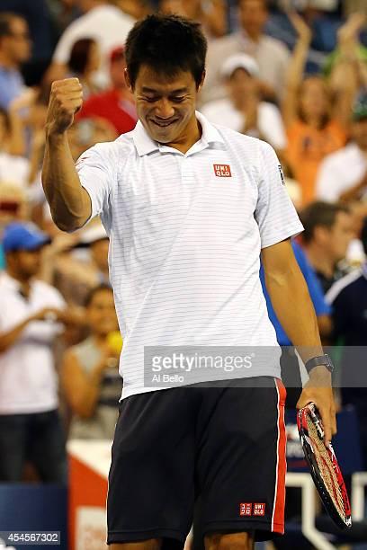 Kei Nishikori of Japan celebrates after defeating Stan Wawrinka of Switzerland in their men's singles quarterfinal match on Day Ten of the 2014 US...