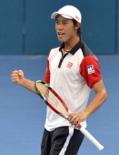Kei Nishikori of Japan celebrates after winning a break point in his match against Marin Cilic of Croatia during day six of the 2014 Brisbane...
