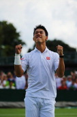 Kei Nishikori of Japan celebrates after winning his Gentlemen's Singles third round match against Simone Bolelli of Italy on day seven of the...