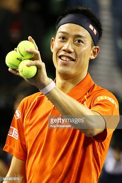 Kei Nishikori of Japan celebrates after winning the men's singles first round match against Borna Coric of Croatia on day one of Rakuten Open 2015 at...