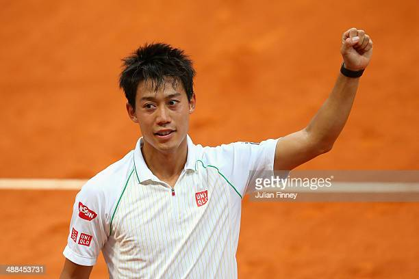 Kei Nishikori of Japan celebrates defeating Guillermo GarciaLopez of Spain during day four of the Mutua Madrid Open tennis tournament at the Caja...